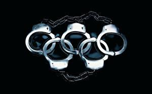 Обои Креатив Наручники cимвол олимпиады из наручников