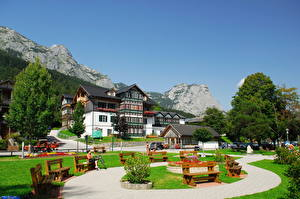 Картинка Австрия Дома Небо Горы Ландшафтный дизайн Скамья Дизайна Штирия Грундльзе Города