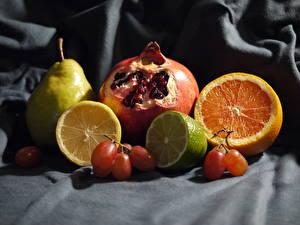 Картинка Натюрморт Цитрусовые Лимоны Гранат Апельсин