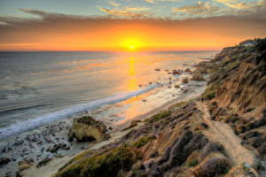 Картинки Побережье США Море Рассвет и закат Пляже Облачно Горизонта HDRI Калифорния Малибу Солнца Природа